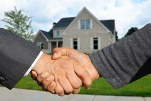 international moving companies in Lebanon shaking hands in front of the house