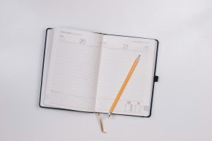 a planner with a pen