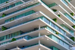 Contemporary white building with emerald colour windows in Beirut