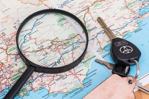 Map, magnifying glass and car keys