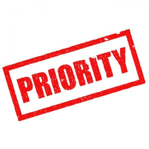 A sign that says priority